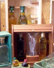 Estuches para aceite, aceiteras y vinagreras.